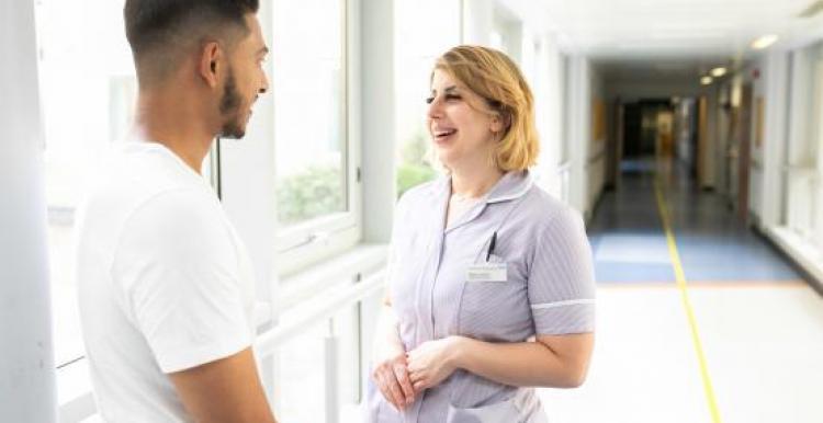 nurse and man talking
