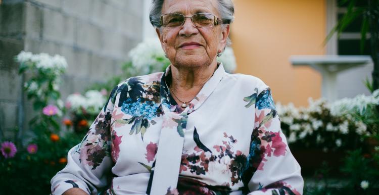 Elderly woman sitting outside
