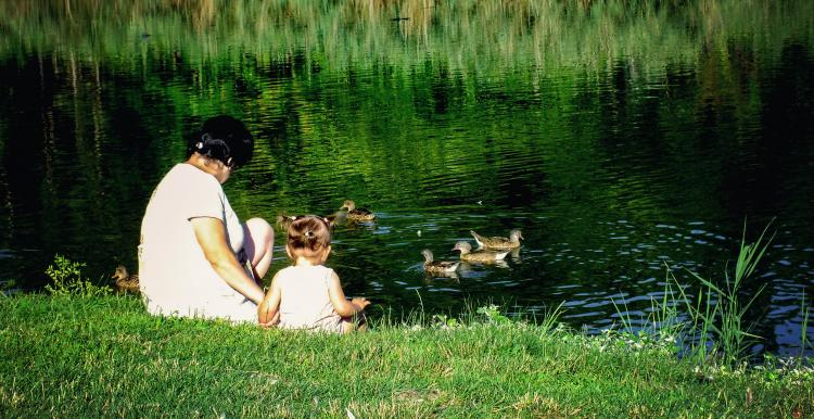 woman with baby by lake