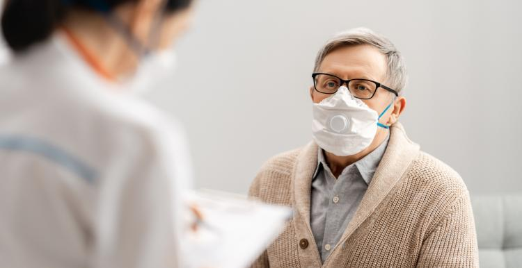 man with facemask at doctors office