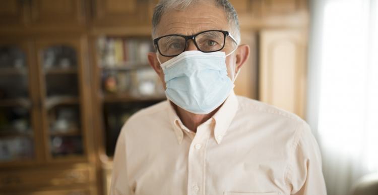 Elderly man wearing a mask