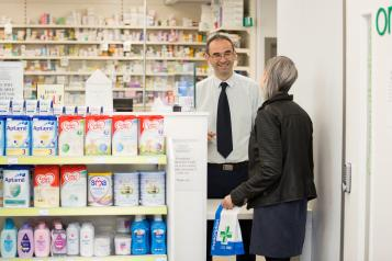 two people at the pharmacy
