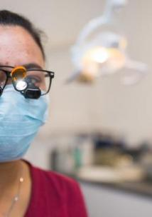 Smiling dentist with mask
